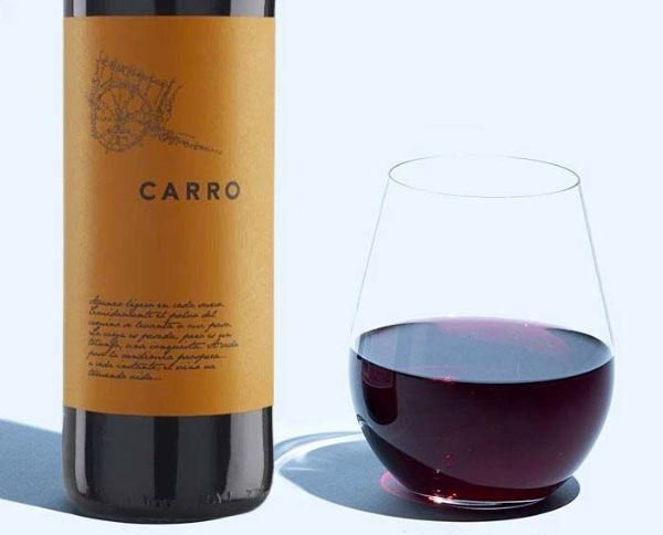 Photo of bottle and glass of Carro by Señorío De Barahonda 2019 against a white backdrop.