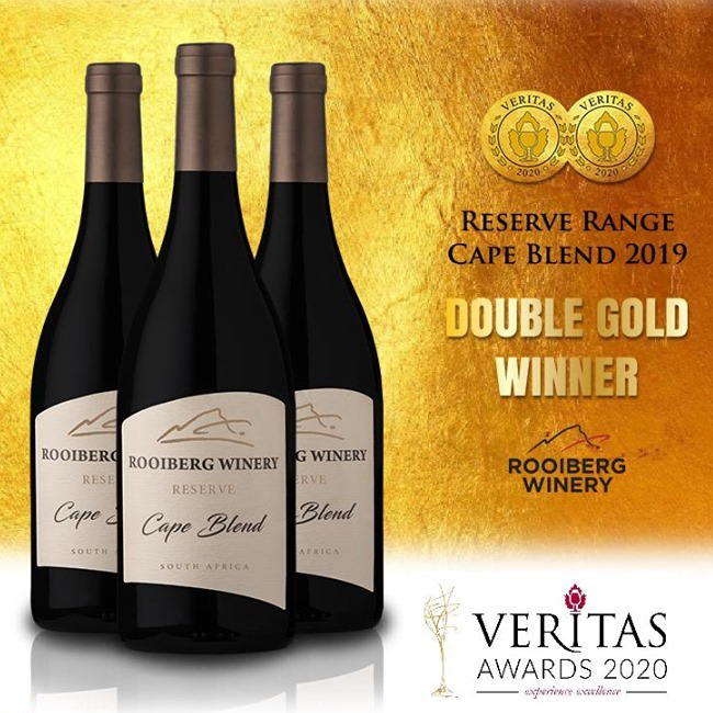 3 bottles of Reserve Cape Blend by Rooiberg Winery 2019 shown against a yellow background displaying the Double Gold Winner medals from Veritas Awards 2020.