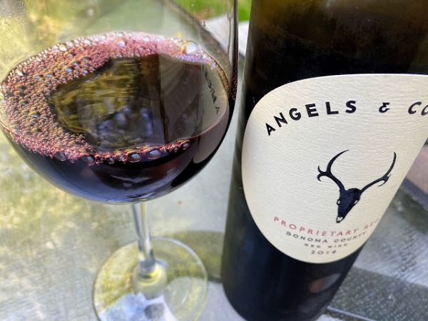 Bottle and glass of Angels & Cowboys Proprietary Red2018