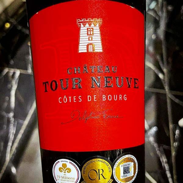 Stunning red label on bottle of Bordeaux Cotes De Bourg 2019 by Chateau Tour Neuve.