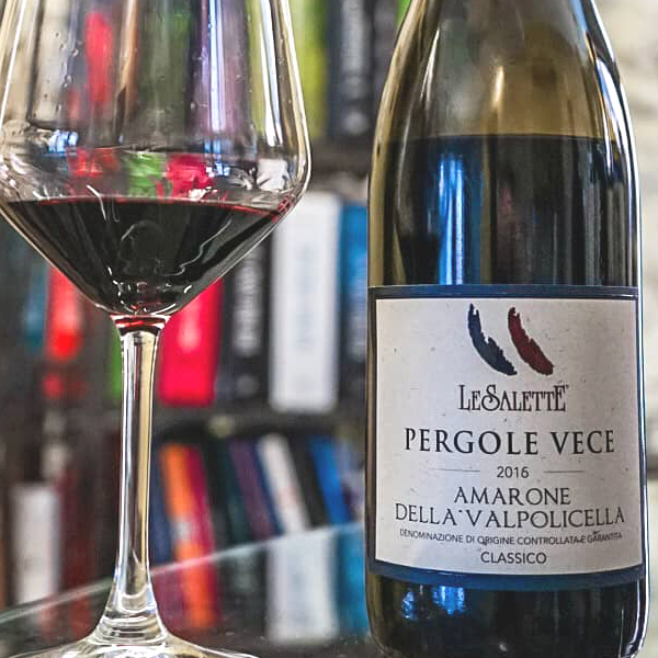 Bottle and glass of Amarone Della Valpolicella Classico DOCG Pergole Vece by Le Salette 2016.