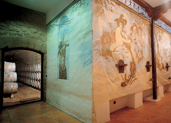 The  cellar of Bodegas Palacio producer of Cosme Palacio Rioja Vendimia Seleccionada showing wall frescos.