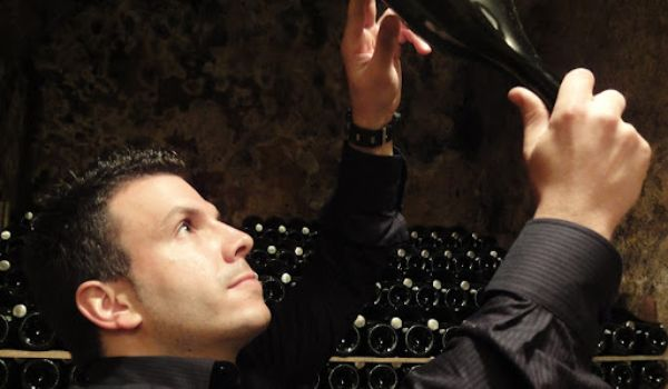 Ramon Canals, producer of Duran Cava Gran Reserva Brut 2016 testing wine in the wine cellar.