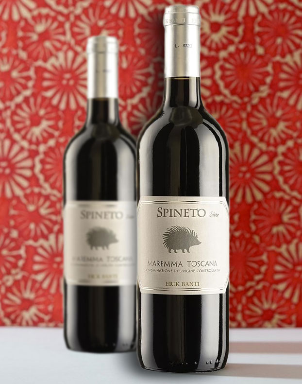Two bottles of Spineto Maremma Toscana DOC 2018 by Erik Banti shown against a floral background.