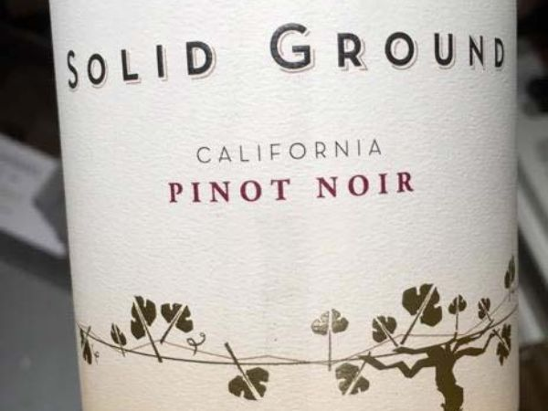 Label of bottle of  Pinot Noir by Solid Ground 2018.