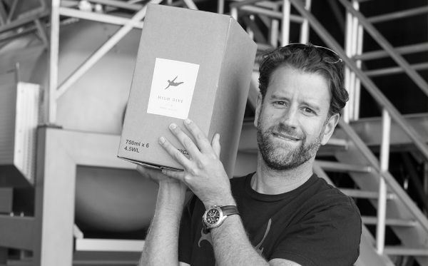 Photo of  Yoav Gilat, producer of Cabernet Sauvignon California by Cannonball 2018 carrying a case of wine.