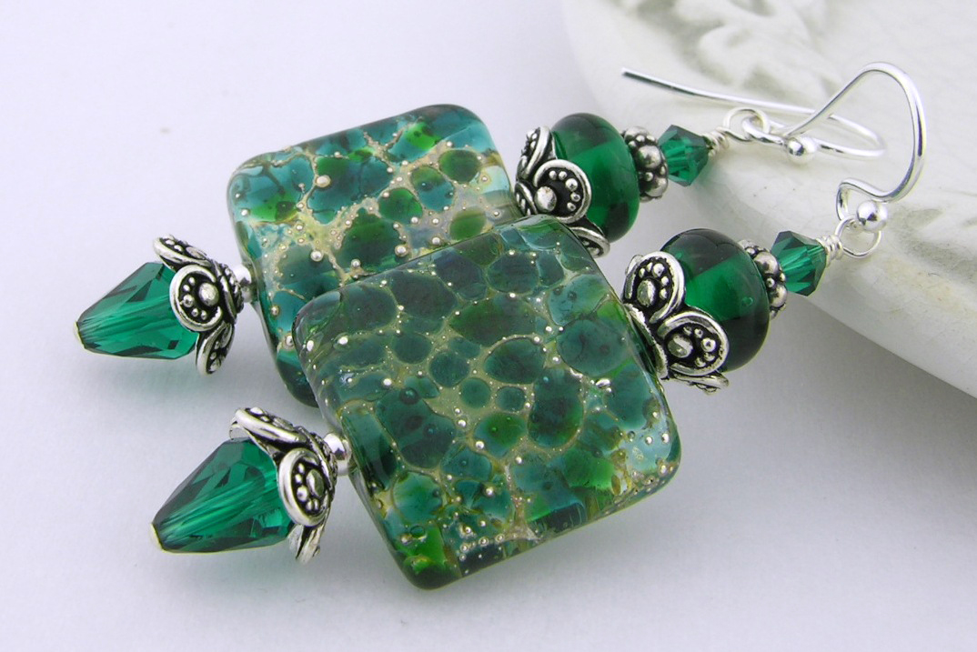 Artisan made dark green earrings with handmade dark green and square lampwork glass, Swarovski crystals and sterling silver.