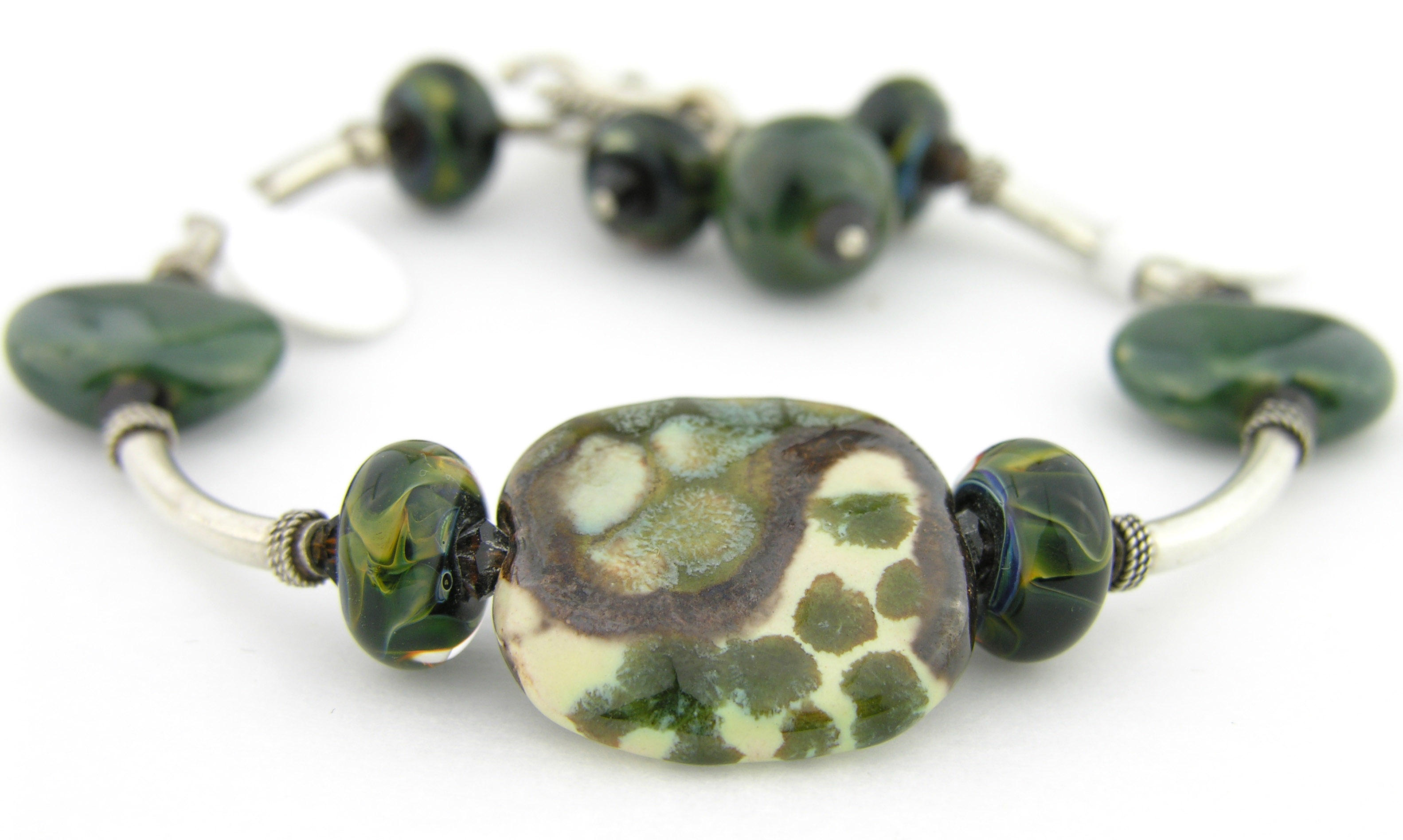 Deep In The Forest Bracelet - Handmade dark green and brown bracelet with artisan lampwork, ivory Kazuri ceramic beads, Swarovski crystals and sterling silver